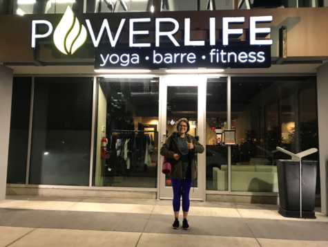 Carmen Macias, '20, stands outside Power Life after a relaxing yoga class.